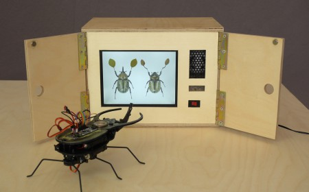 Home theater is open and Cyberbeetle is enjoying the music video. The beetle is normally quite grumpy but an IR signal from the box makes it dance when the music video is playing. -- CC BY / Kati Hyyppä