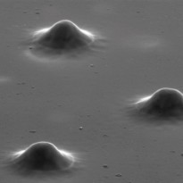 Electron microscope image of three quantum-dot microlenses serving as single-photon emitters in quantum communications. Technology: AG Reitzenstein, TU Berlin.
